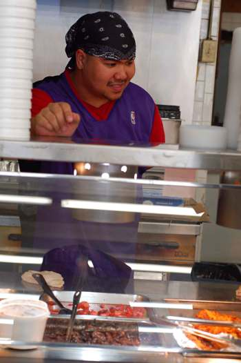 Mark behind the counter at Oriental Market